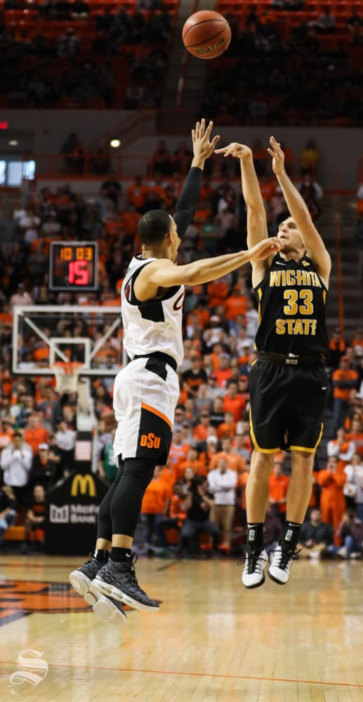 Wichita+State+guard+Conner+Frankamp+drains+a+three+point+basket+over+Oklahoma+State+guard+Kendall+Smith++during+the+second+half+in+Gallagher-Iba+Arena+on+Saturday.