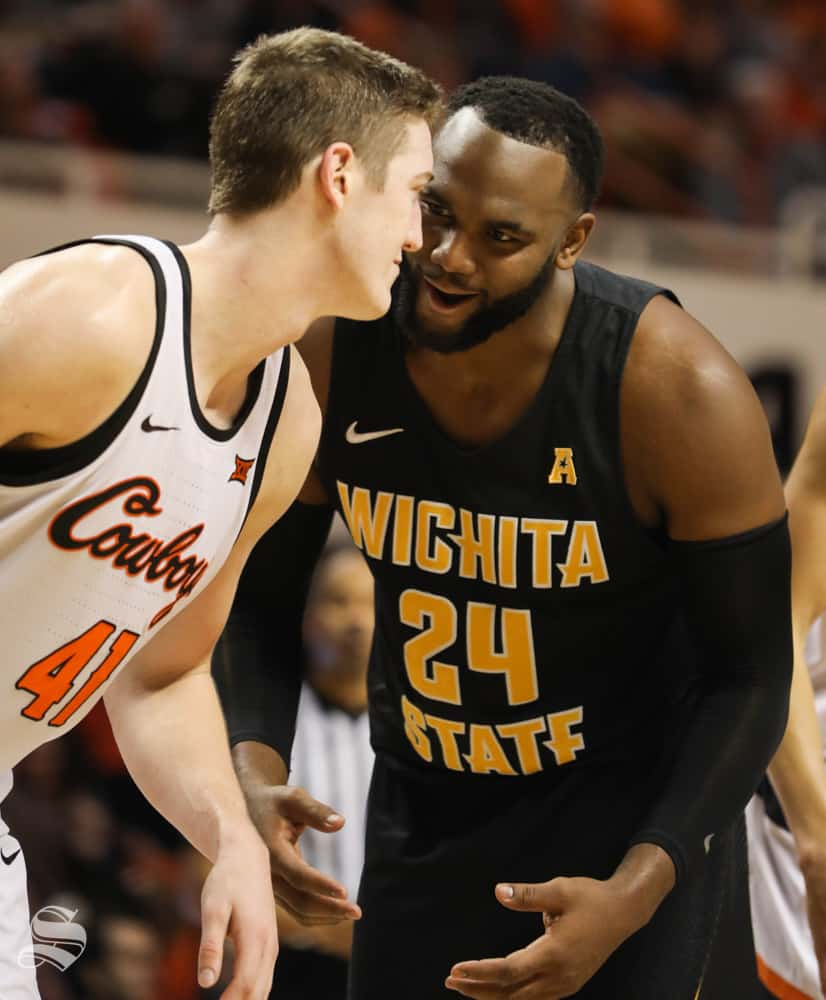 Wichita+State+center+Shaquille+Morris+and+Oklahoma+State+forward+Mitchell+Solomon+chat+during+a+free+throw+in+the+second+half+in+Gallagher-Iba+Arena+on+Saturday.