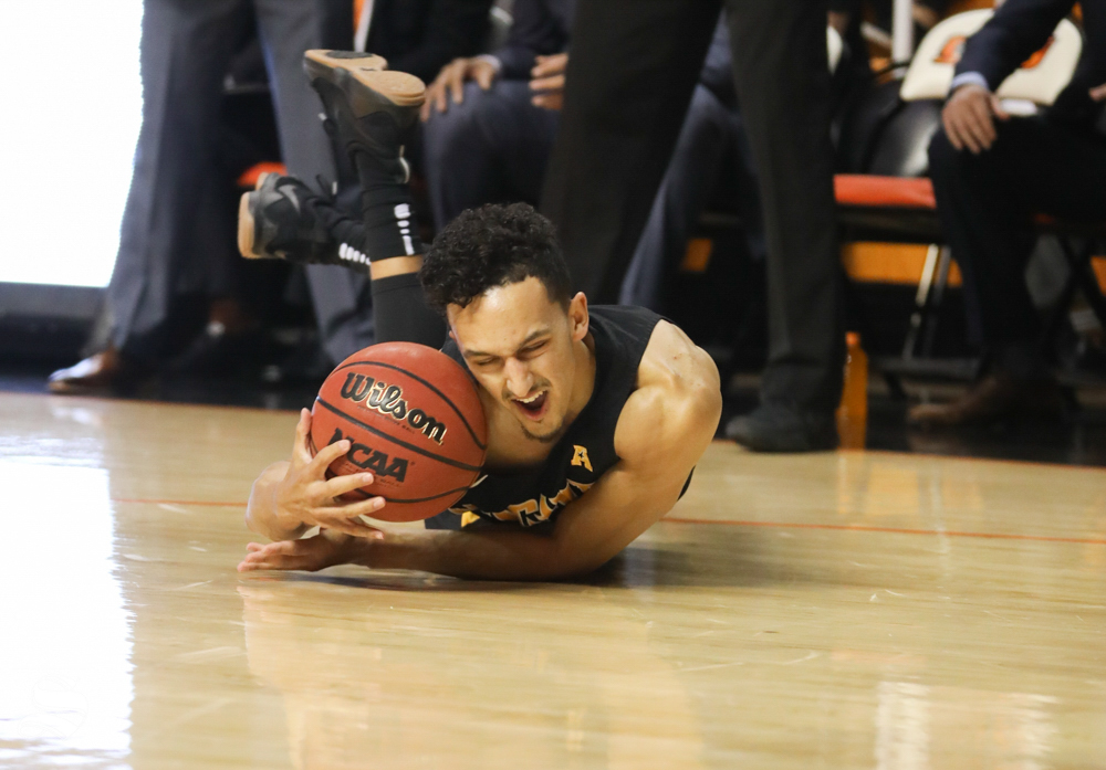 Wichita State guard Landry Shamet hits the ground after contact from a Oklahoma State player in Gallagher-Iba Arena on Saturday.
