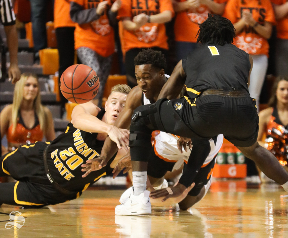 Wichita+State+center+Rauno+Nurger+and+Wichita+State+forward+Zach+Brown+fight+for+a+ball+against+Oklahoma+State+forward+Cameron+McGriff+during+the+first+half+in+Gallagher-Iba+Arena+on+Saturday.