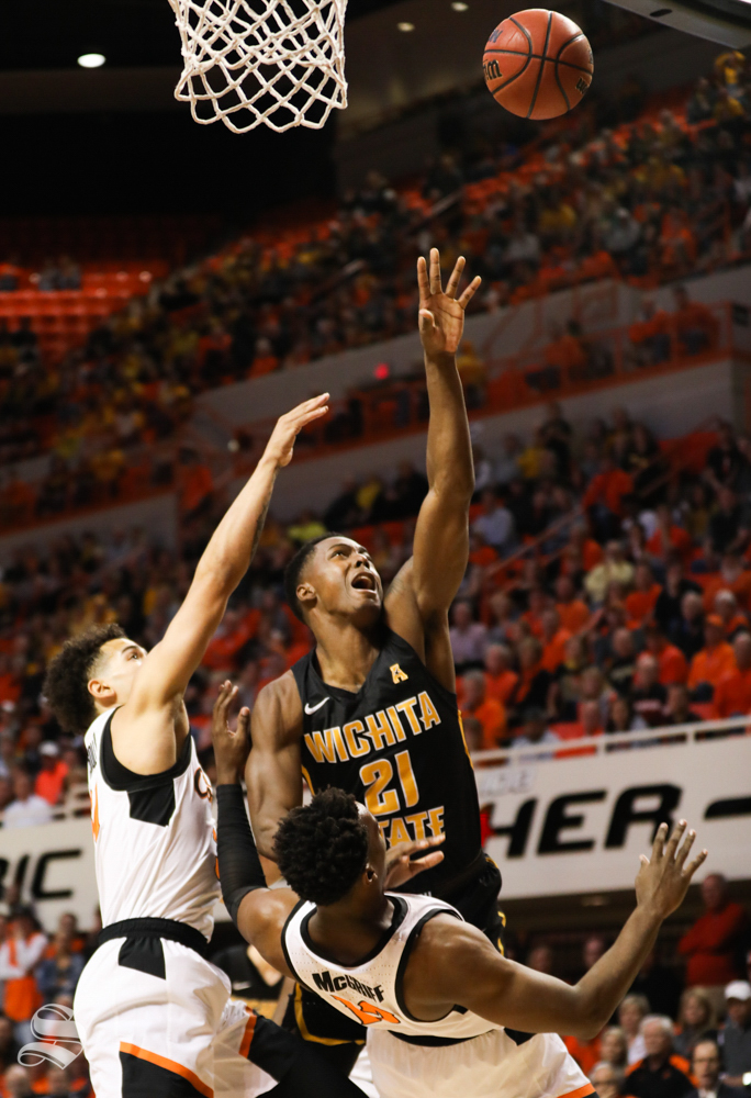 Wichita+State+forward+Darral+Willis+Jr.+charges+Oklahoma+State+forward+Cameron+McGriff+while+driving+for+the+rim+during+the+first+half+in+Gallagher-Iba+Arena+on+Saturday.