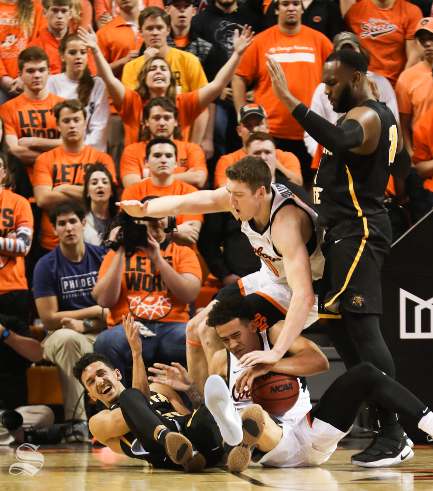 Oklahoma+State+guard+Jeffrey+Carroll+and+Oklahoma+State+forward+Mitchell+Solomon+land+on+top+of+Wichita+State+guard+Landry+Shamet+during+a+scuffle+for+a+ball+during+the+first+half+in+Gallagher-Iba+Arena+on+Saturday.