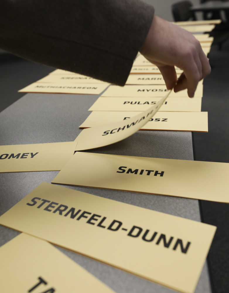 Name plates for faculty senators are laid out on a table before the start of a Faculty Senate meeting in January.