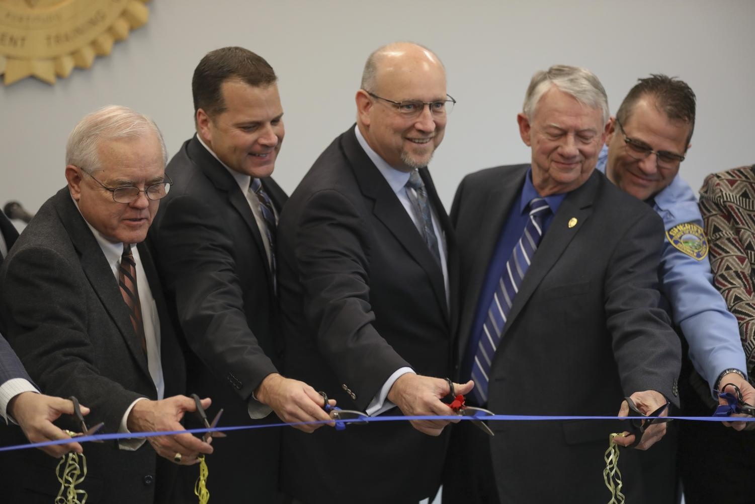 Wichita and Sedgwick County officials cut the ribbon on the new Law Enforcement Training Center on Wichita State's Innovation Campus.
