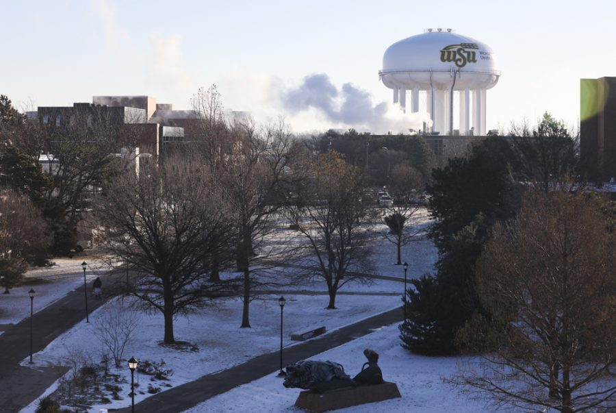 Students+bundles+up+for+the+first+day+of+Spring+classes+on+Wichita+State+campus.+The+start+of+classes+was+delayed+due+to+dangerous+windchill.