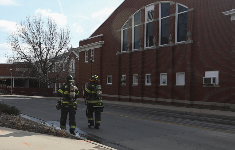 Firefighters respond to a call at Henrion Hall on Friday morning.