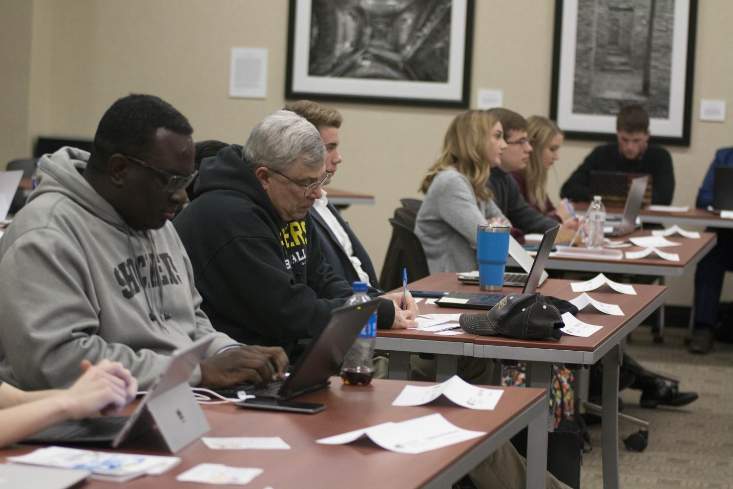 Senators listen as officer reports are given Wednesday evening during the SGA meeting.