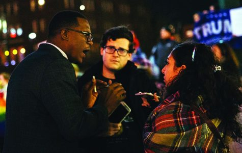 Former Sunflower reporter Nathan Davis, center, and Jenna Farhat speak to Djuan Wash during an anti-Trump rally before Davis' death in Febuary of 2017.