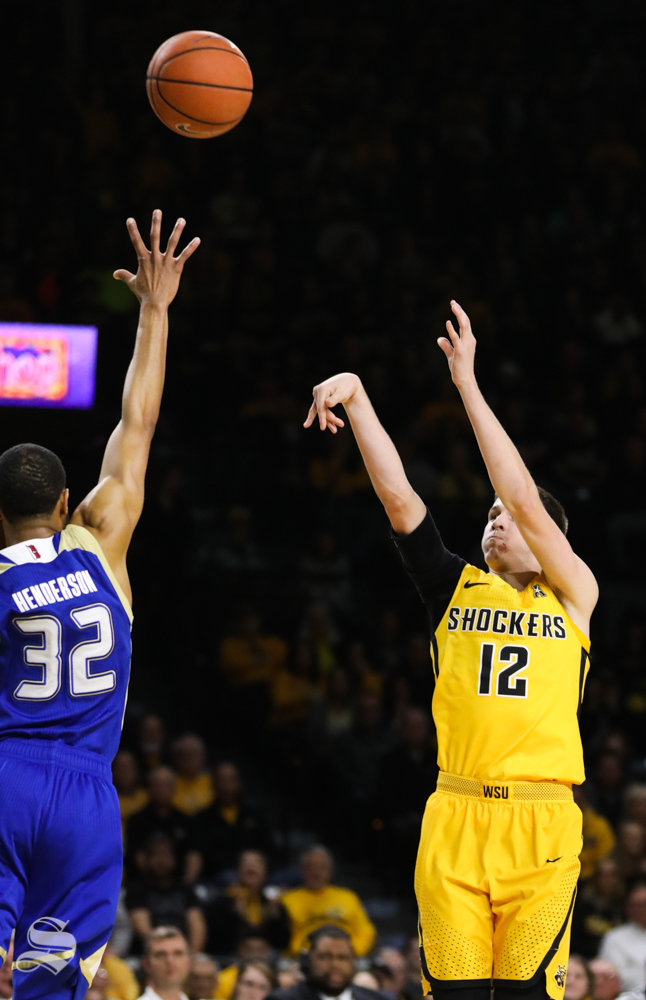 Wichita+State+guard+Austin+Reaves+drains+a+three+point+basket+over+Tulsa+guard+Corey+Henderson+Jr.+during+the+first+half+at+Koch+Arena.