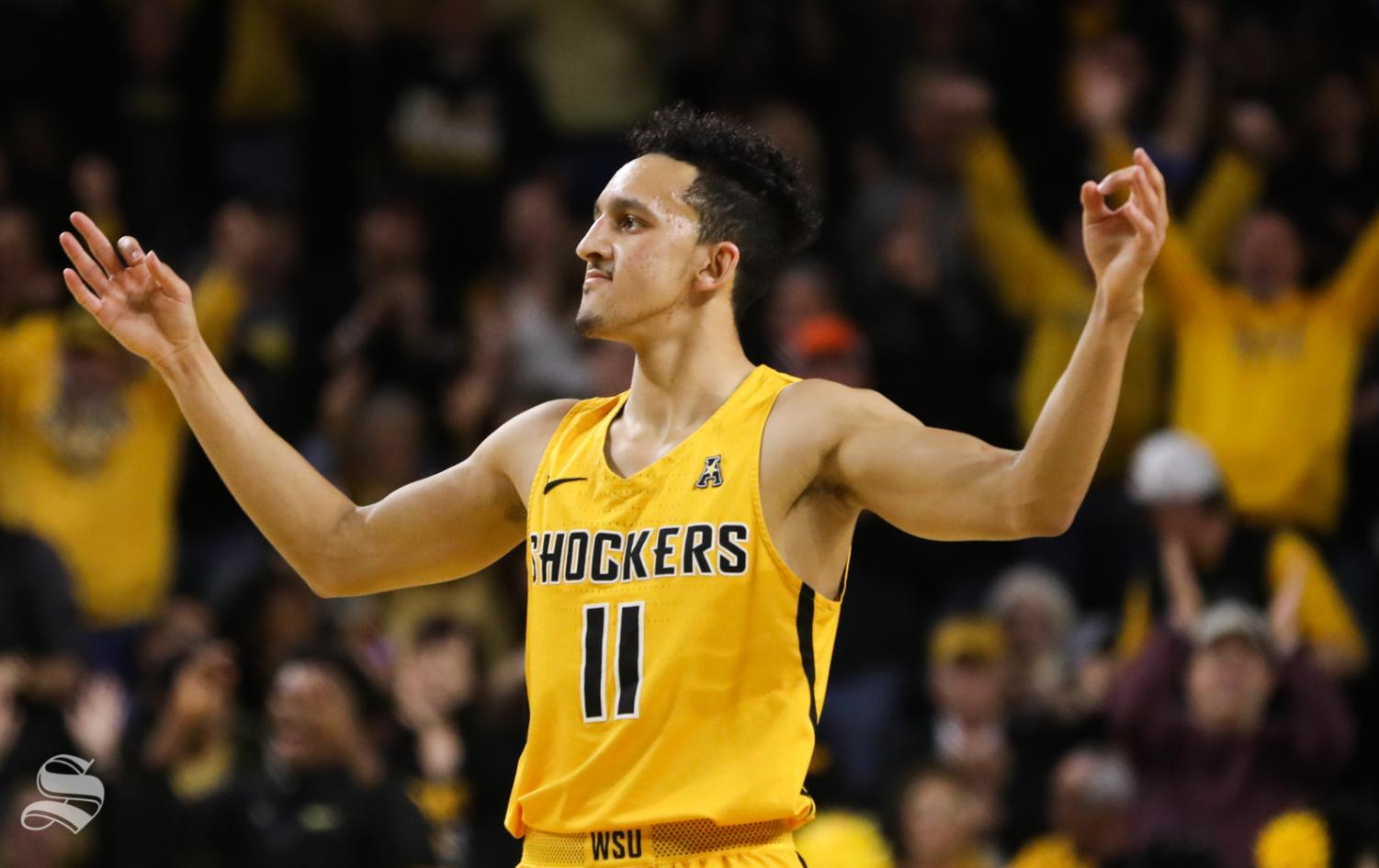 Landry Shamet celebrates a three-point shot during a Shocker victory over Tulsa last season.