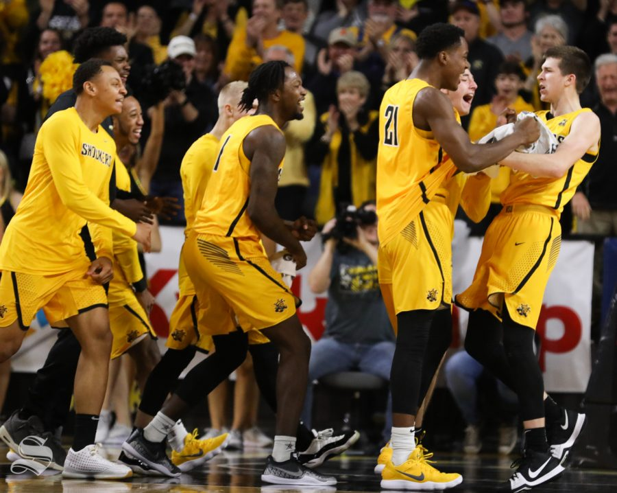 Wichita+State+Shockers+celebrates+with+Wichita+State+guard+Austin+Reaves%2C+right%2C+after+Reaves+finished+the+first+half+7-8+from+beyond+the+arc+against+the+Tulsa+Golden+Hurricane+at+Koch+Arena.