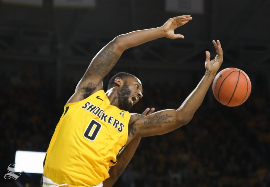 Wichita State forward Rashard Kelly attempts to get the rebound during the first half against the Tulsa Golden Hurricane at Koch Arena.