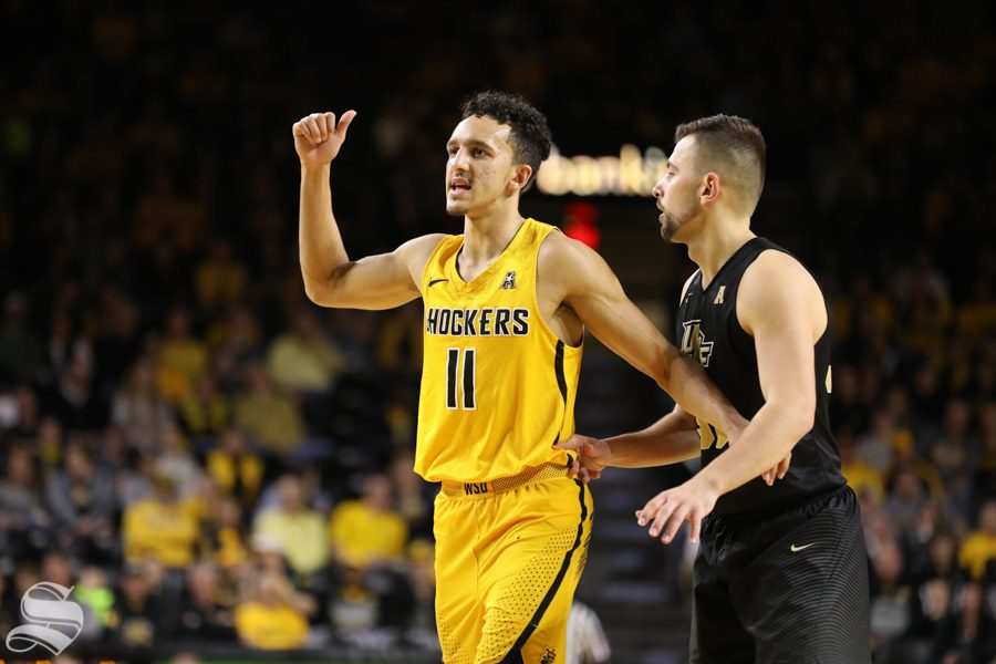 Wichita State guard Landry Shamet guards a UCF player Wednesday night in Koch Arena.