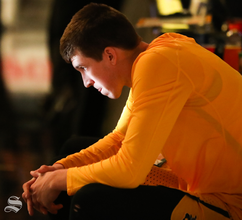 Wichita State guard Austin Reaves sits on the bench before being announced at the game against the UCF Knights at Koch Arena.
