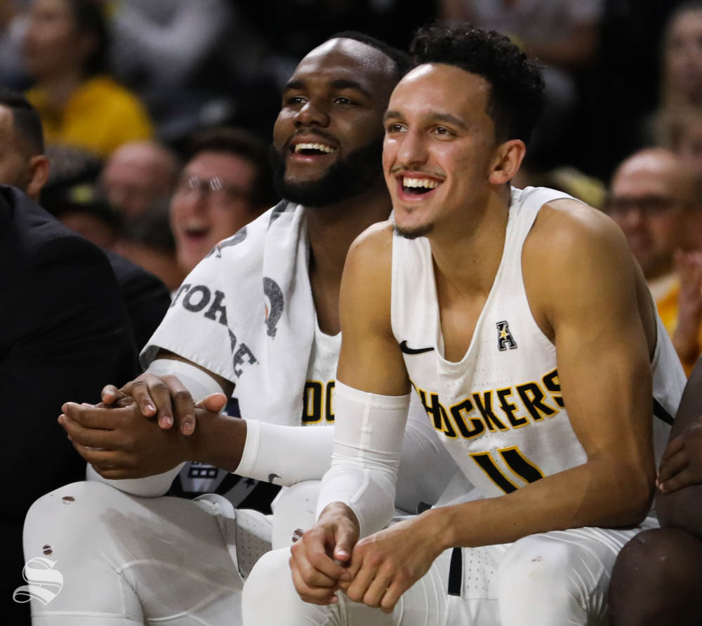 Wichita State center Shaquille Morris and Wichita State guard Landry Shamet smile during a Shocker free throw attempt against the Houston Cougars during the second half in Koch Arena.