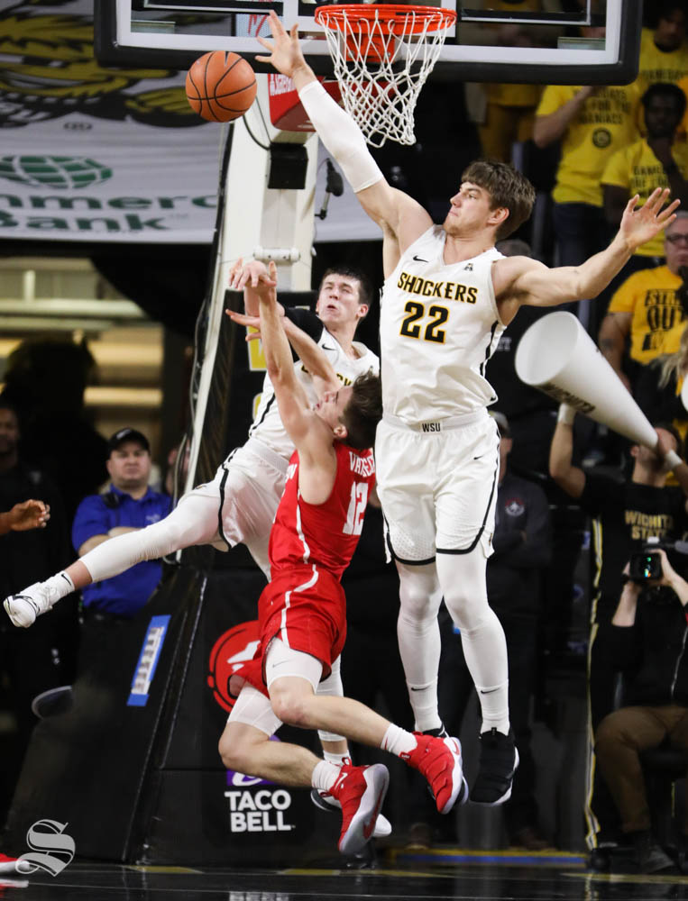Wichita+State+center+Asbjorn+Midtgaard+attempts+to+block+a+shot+while+Wichita+State+guard+Austin+Reaves+fouls+Houston+guard+Wes+VanBeck+during+the+second+half+in+Koch+Arena.