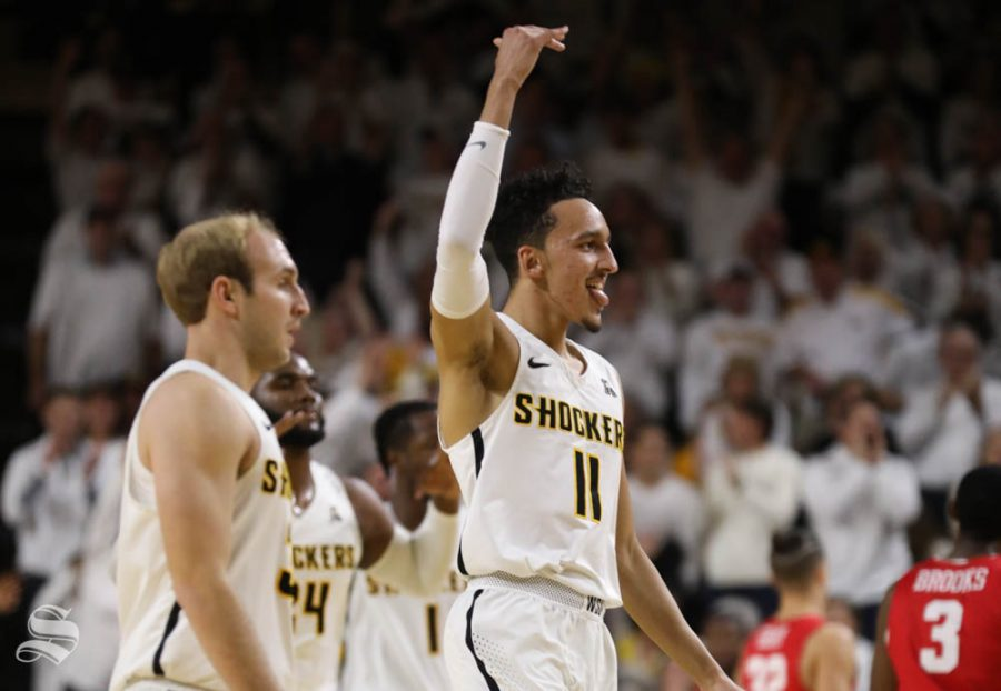 Wichita State guard Landry Shamet and Wichita State guard Conner Frankamp walk off the courts after a three point basket from Frankamp during the first half against the Houston Cougars in Koch Arena.