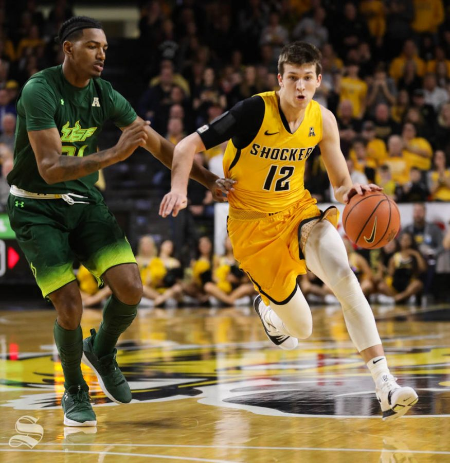 Wichita State guard Austin Reaves drives to the basket against South Florida forward Tulio Da Silva during the first half in Koch Arena.