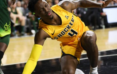 Wichita State guard Samajae Haynes-Jones grimaces after being hit in the face by South Florida forward Malik Martin during the first half in Koch Arena.