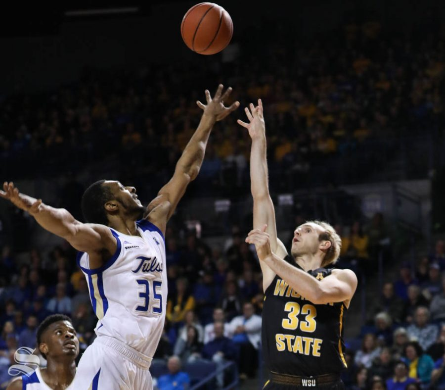Wichita State guard Conner Frankamp scores over Tulsa forward Geno Artison during the first half in Reynolds Center.