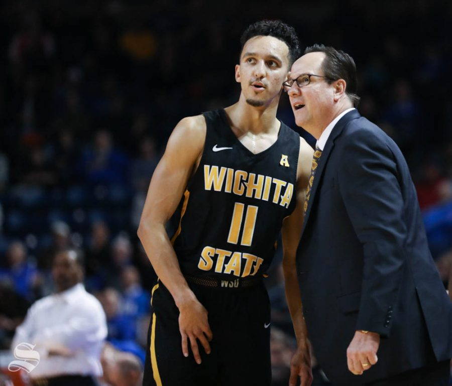Wichita State guard Landry Shamet and Wichita State head coach Gregg Marshall talk during a free throw against the Tulsa Golden Hurricane during the second half in Reynolds Center.