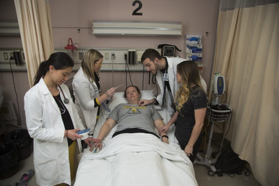 WSU+nursing+students+take+turns+practicing+standard+procedures+on+each+other+at+Wesley+Medical+Center.+The+WSU+School+of+Nursing+hopes+to+collaborate+with+Kansas+State+University+on+a+satellite+program+in+Manhattan.+