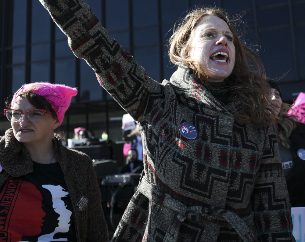 Lacey Cruse leads the crowd in a chant encouraging people to vote during the Women's March on Air Capital in front of Wichita City Hall.
