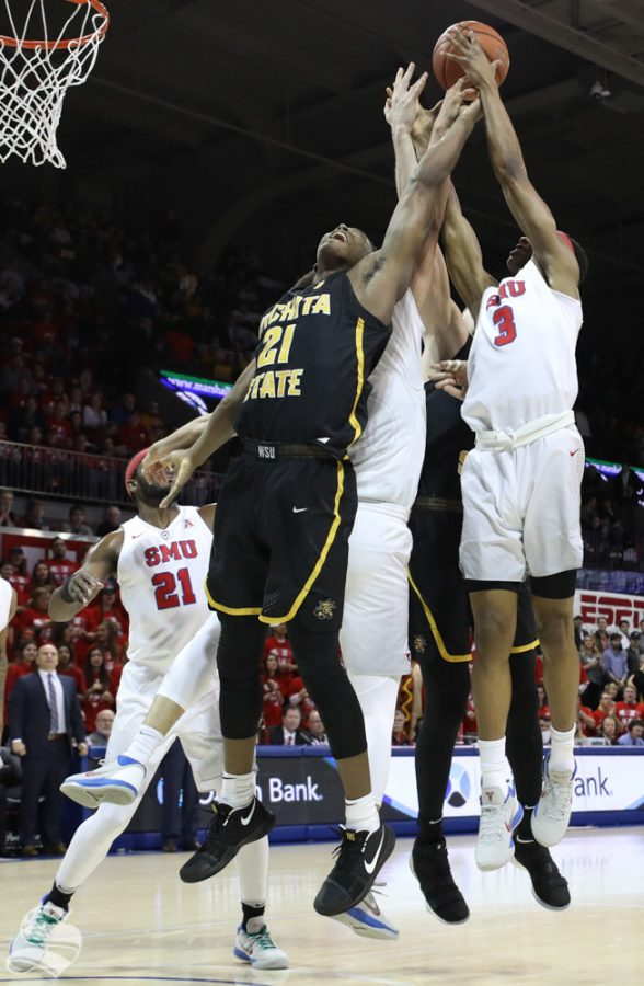 Wichita State forward Darral Willis Jr. fights for a rebound against SMU defenders Saturday at SMU.