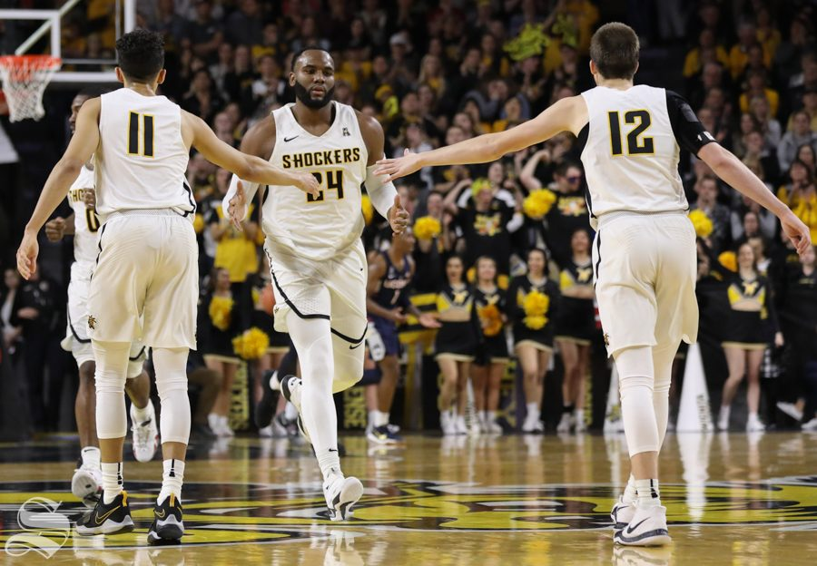 Wichita State center Shaquille Morris high fives Landry Shamet and Austin Reaves Saturday in Koch Arena.