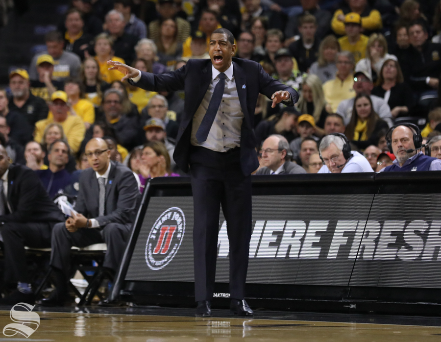 UConn head couch Kevin Ollie yells during the Shockers victory Saturday in Koch Arena.