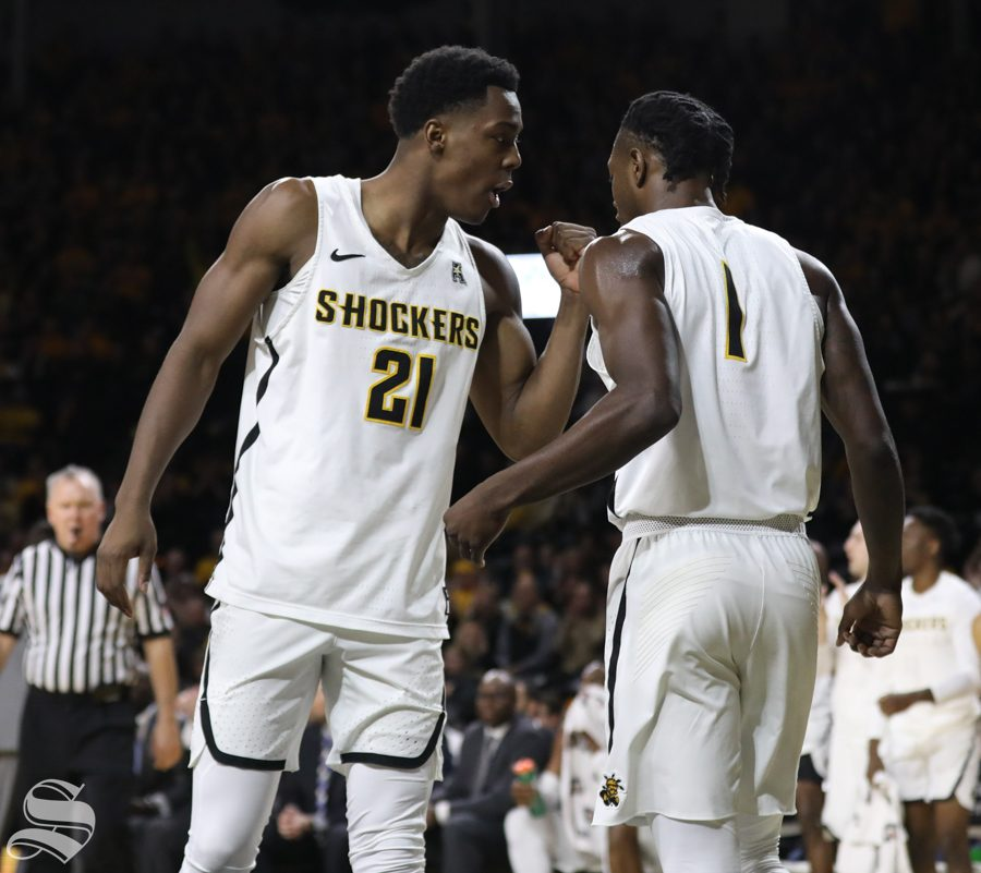 Wichita+State+forward+Darral+Willis+Jr.+talks+to+Zach+Brown+during+the+Shockers+victory+over+UConn+Saturday+in+Koch+Arena.