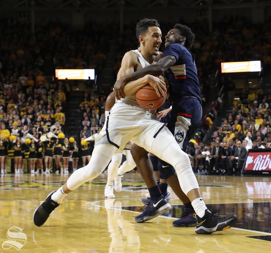 Wichita+State+guard+Landry+Shamet+drives+through+a+UConn+defender+during+the+Shockers+victory+over+UConn.