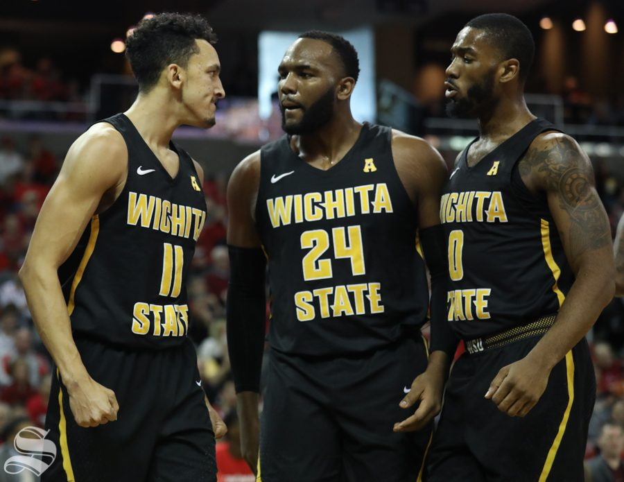 Wichita State guard Landry Shamet celebrates with  Shaquille Morris and Rashard Kelly after a layup by Shamet Sunday against Cincinnati.