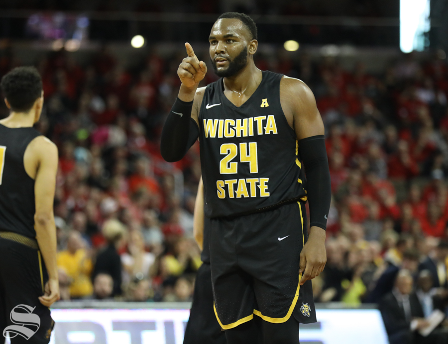 Wichita State center Shaquille Morris points at the rim after a foul Sunday against Cincinnati.