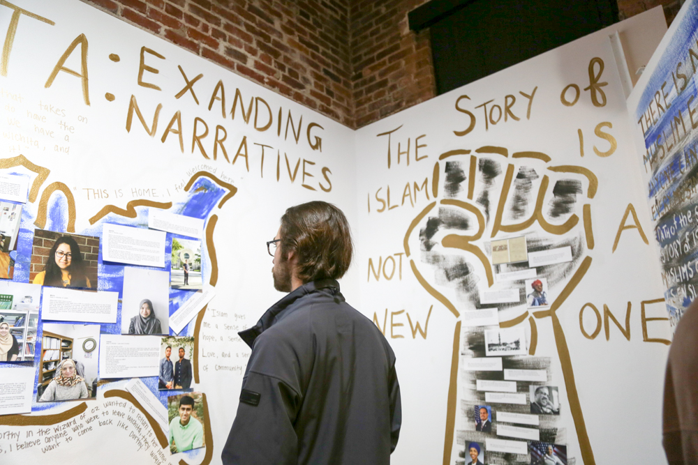 People look at the artwork at the Muslim Student Association's Shiftspace gallery at February's Final Friday.