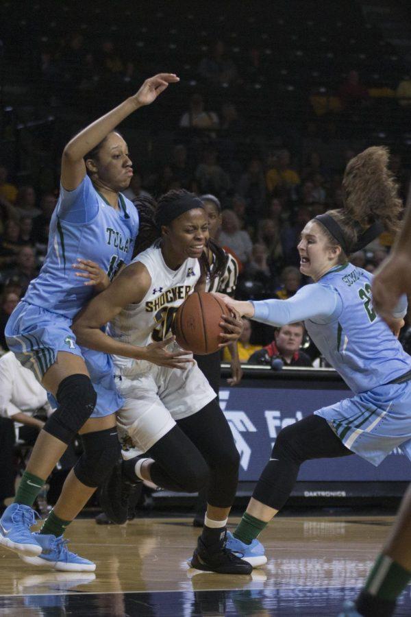 Wichita State Cesaria Ambrosio moves down the court past Tulane defenders.
