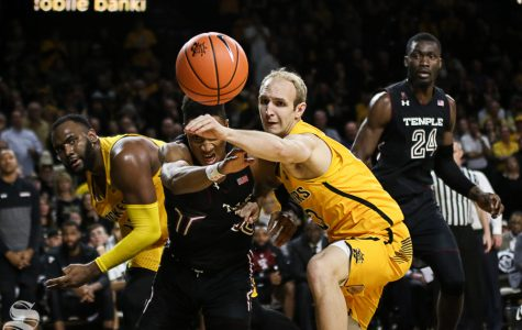 Wichita State guard Conner Frankamp and Temple guard Nate Pierre-Louis hustle for a rebound during the second half at Koch Arena.
