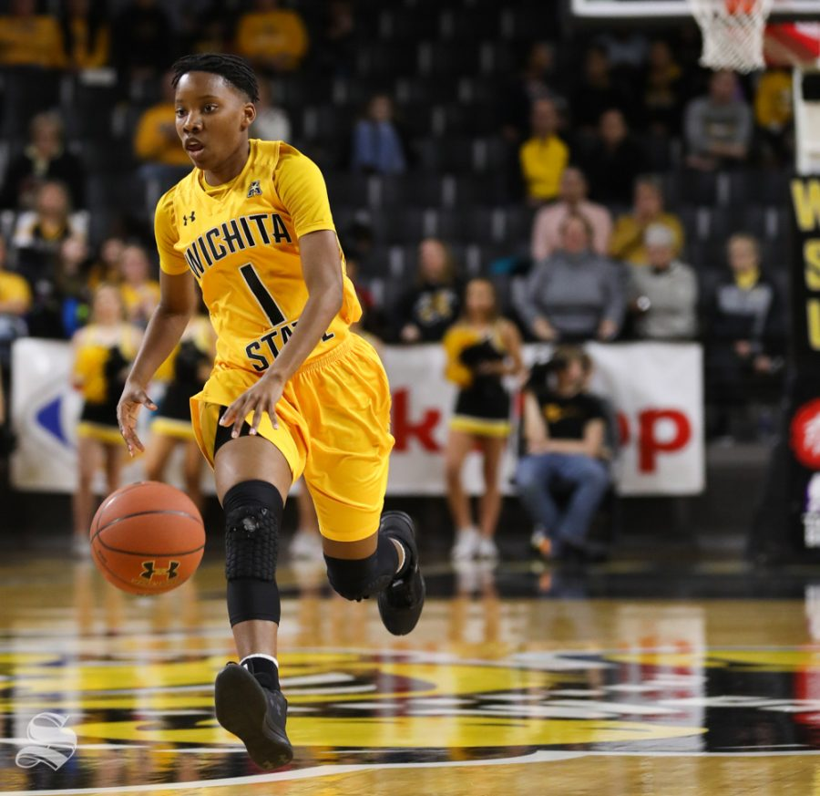 Wichita+State+guard+Keke+Thompson+drives+the+ball+down+court+during+the+first+quarter+of+the+game+against+the+Houston+Cougars+at+Koch+Arena.
