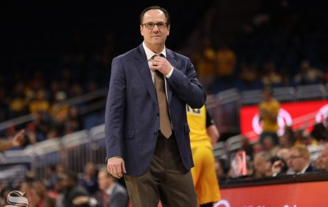 Wichita State head coach Gregg Marshall adjusts his tie during the American Conference Tournament semifinals against Houston.