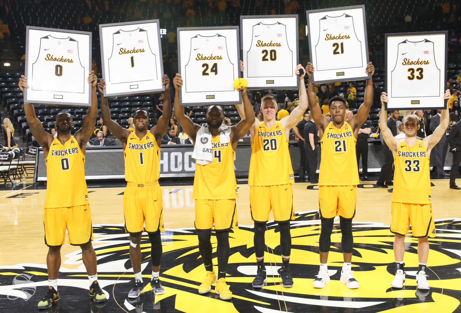 Wichita State's Rashard Kelly, Zach Brown, Shaquille Morris, Rauno Nurger, Darral Willis Jr. and Conner Frankamp at Koch Arena. pose while being honored on senior day at Koch Arena.