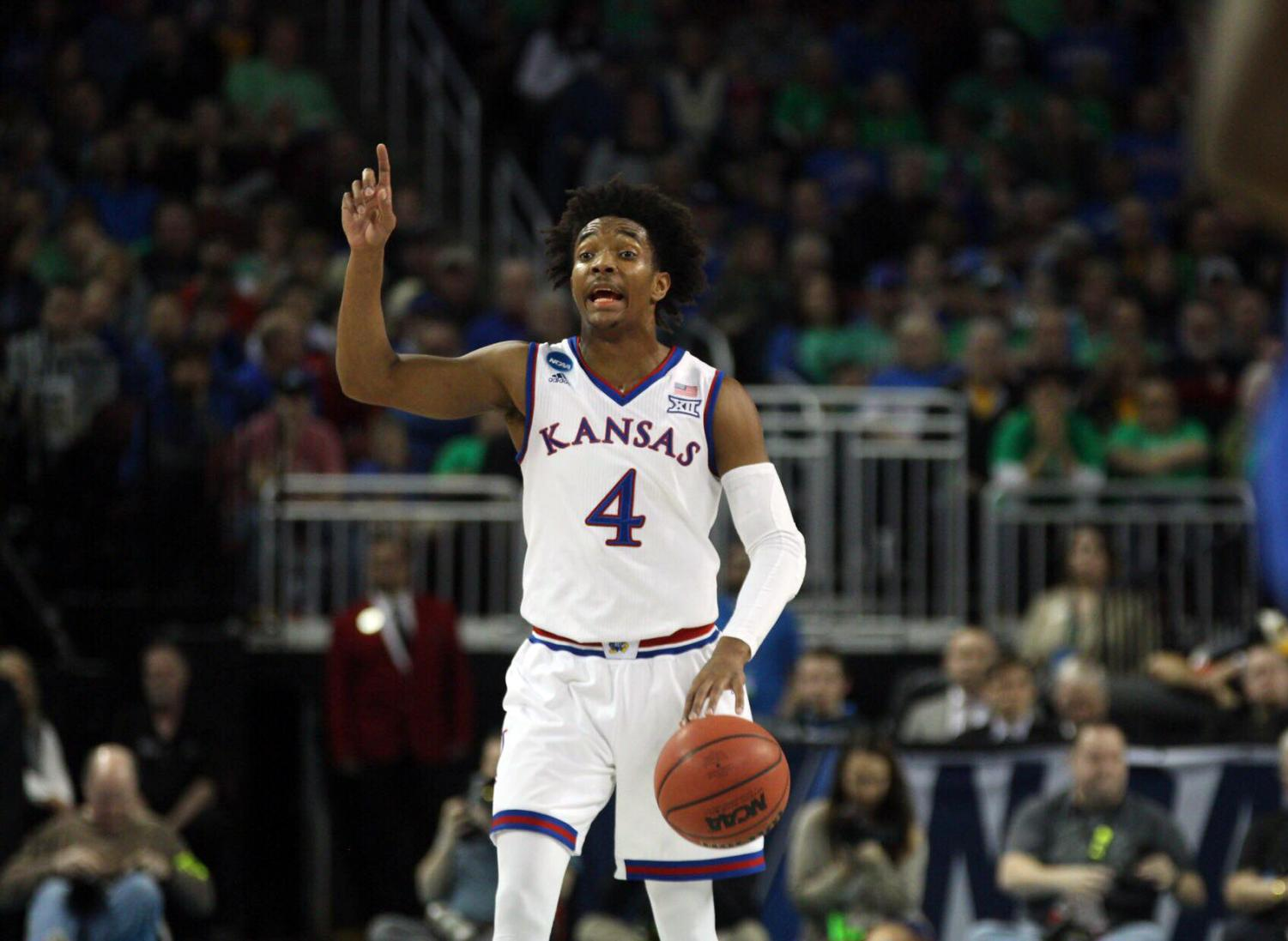 Kansas guard Devonte Graham calls out a play during the first half of the game against Seton Hall in the second round of the NCAA Tournament.