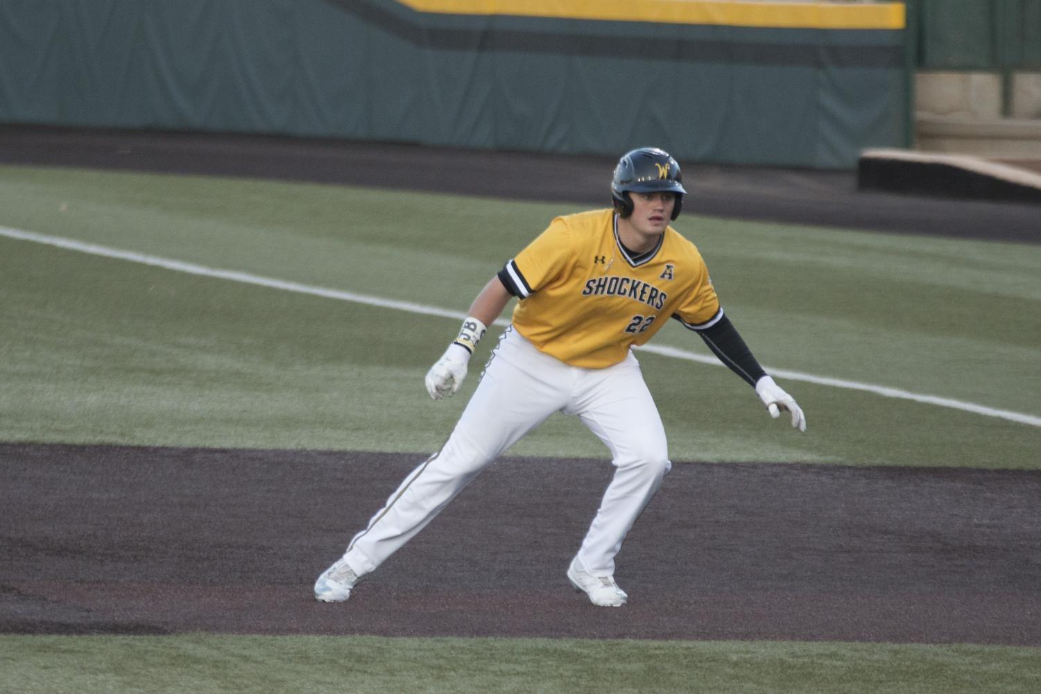 Wichita State Mason O'Brien watches the pitch from first base during the game against the Sooners.