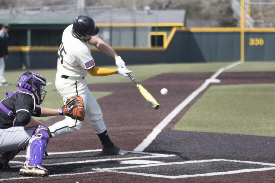 Wichita State's Dayton Dugas hits against Furman in the second game of the weekend series.