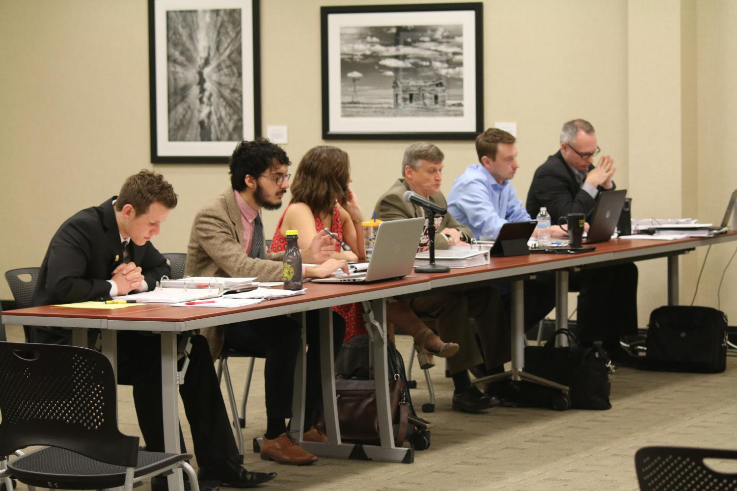 The Student Fee Committee deliberates student fee allocations. The committee voted to cut The Sunflower's funding by a third.