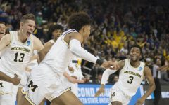 PHOTOS: Poole's buzzer-beater advances Michigan, knocks off Houston