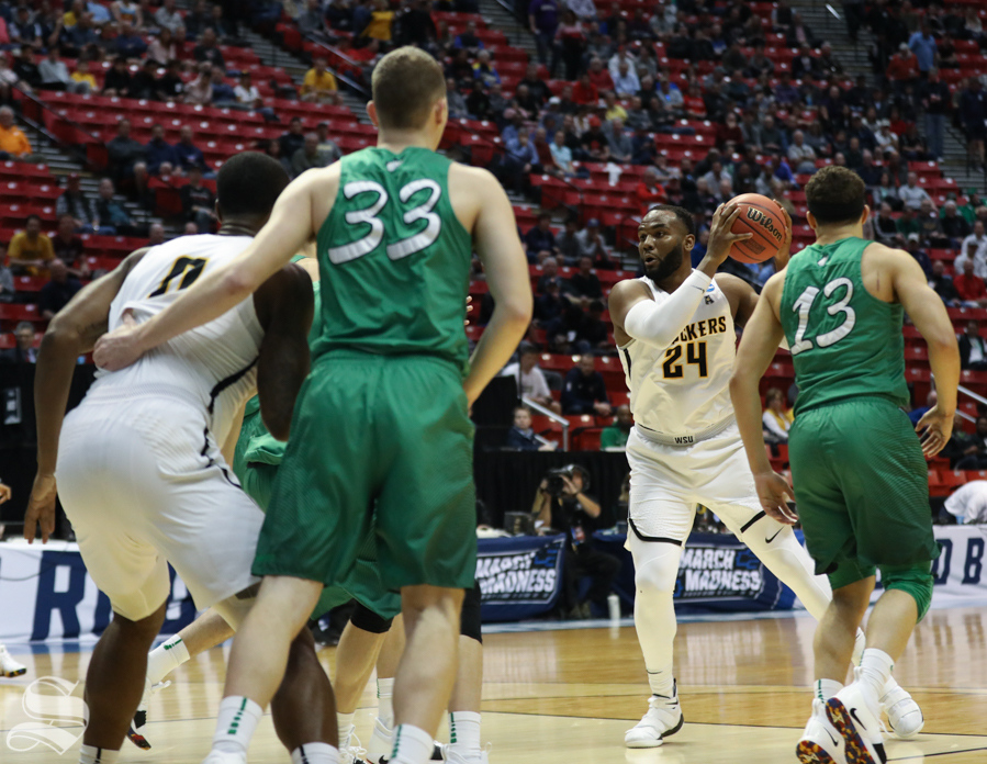 Wichita State center Shaquille Morris (24) looks for a play against Marshall during the First Round game of the NCAA men's college basketball tournament in San Diego.