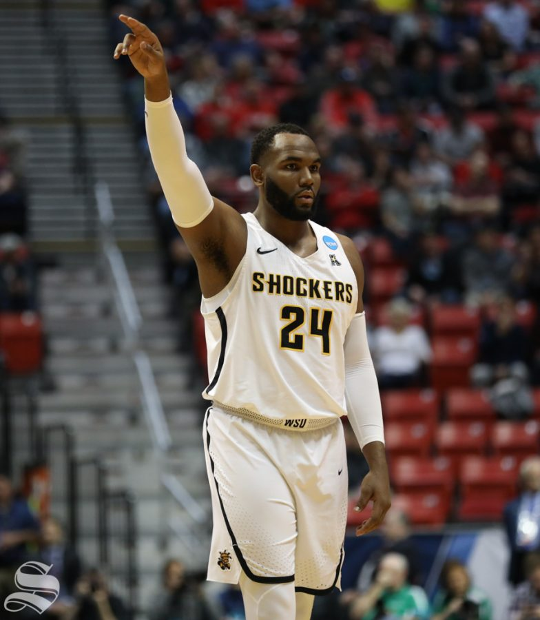 Wichita State center Shaquille Morris (24) points to a teammate during the First Round game of the NCAA men's college basketball tournament in San Diego.