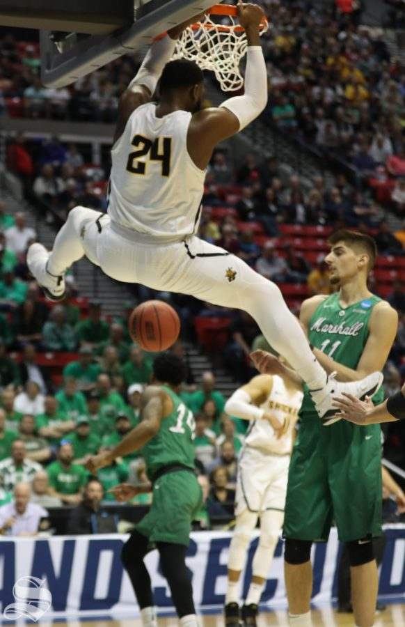 Wichita State center Shaquille Morris (24) hits a dunk during the First Round game of the NCAA men's college basketball tournament in San Diego.