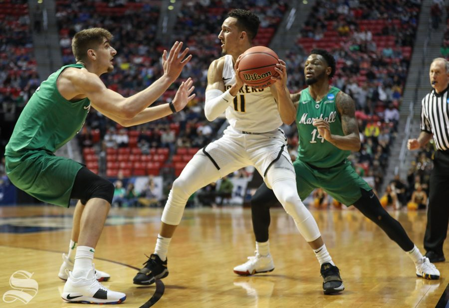 Wichita State guard Landry Shamet (11) tries to make room during the First Round game of the NCAA men's college basketball tournament in San Diego.