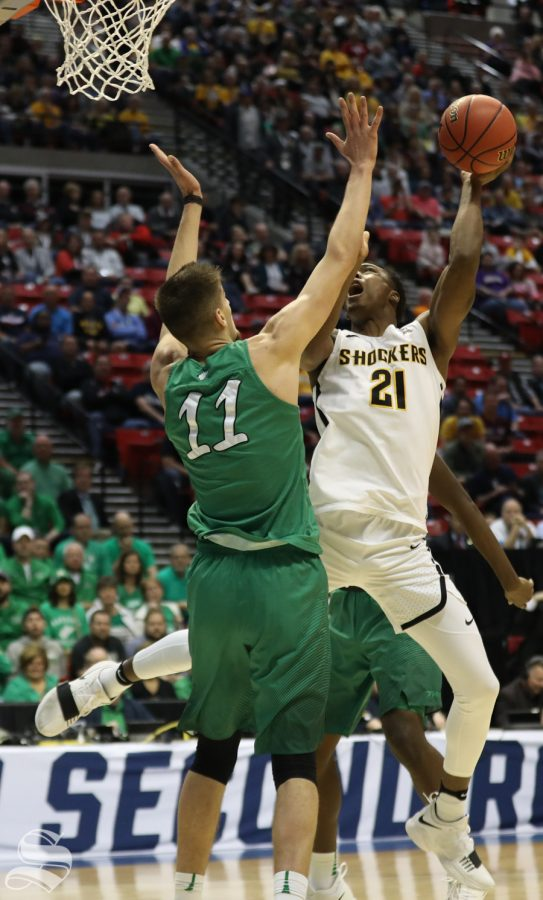Wichita State forward Darral Willis Jr. (21) goes up against Marshall forward Ajdin Penava (11) during the First Round game of the NCAA men's college basketball tournament in San Diego.